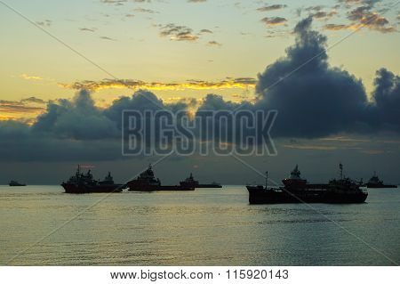 Silhouette Of The Supply Vessels At Sunrise.