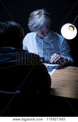 Policewoman Analysing Evidence