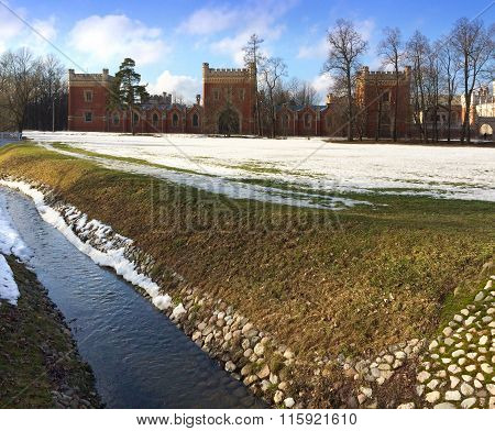 The stream in spring flows in a frame of thawing snow. Alexandria park suburb of St. Petersburg