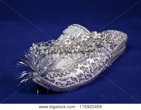 east style bride wedding shoes on a blue velvet and wedding diadem