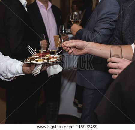 Assorted Canape Dish Held By Waiter