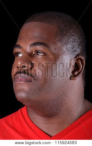 Closeup of a handsome serious African American Man on a black background