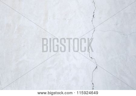 White stucco wall with cracked plaster. Background texture.