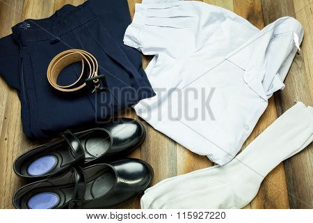 Thai Student girl uniform with wooden background on top view