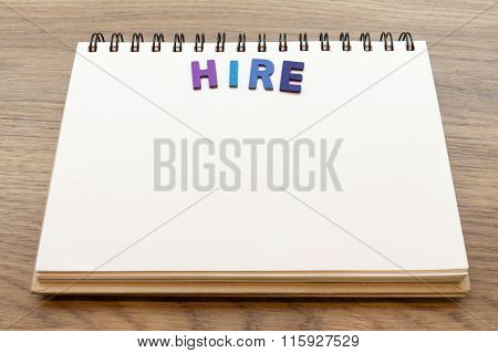 Wood Colorful Letter Word Hire Lay Down Notebook On Wood Background