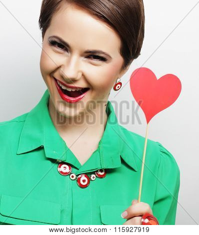 Young happy woman holding red  paper heart