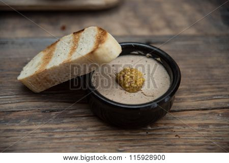Appetizer in small bowls are on the table, and next is the bread or pita bread