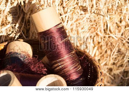 Silk Threads In A Coils On Blurred Background