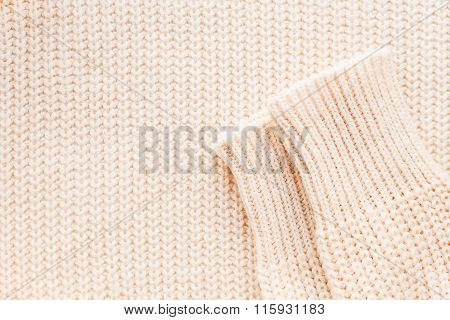 Abstract Knitted Background. Wool Sweater With Sleeves. Close Up Picture Of  Knitted Pattern.