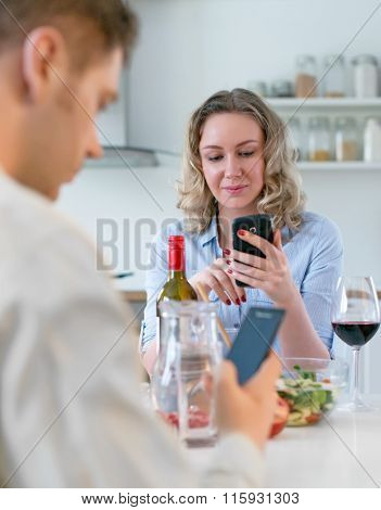 Young couple having dinner at home. Modern relationships.