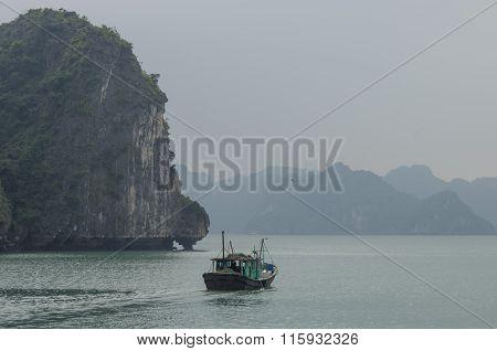 Fishing Boat In Ha Long Bay, Vietnam. Cloudy Winter Weather
