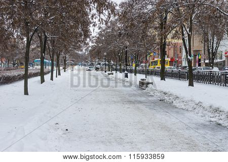 Karl Marx avenue of the Dnepropetrovsk city covered by ice and snow at workday at winter season