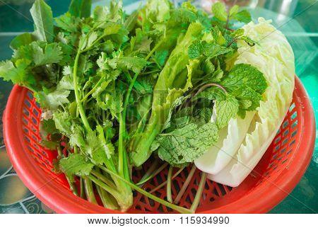Group Of Vegetable In Red Basket