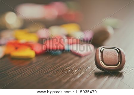 Buttons Lie On The Wooden Oak Table. Stylized Picture With An Old Camera