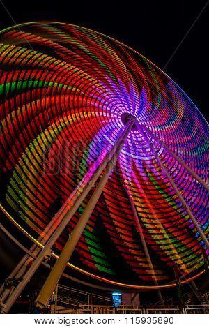 Spiral ferris wheel lights at night