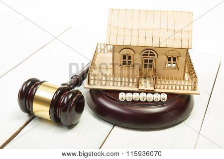Auction. Law. Miniature House on wooden table and Court Gavel