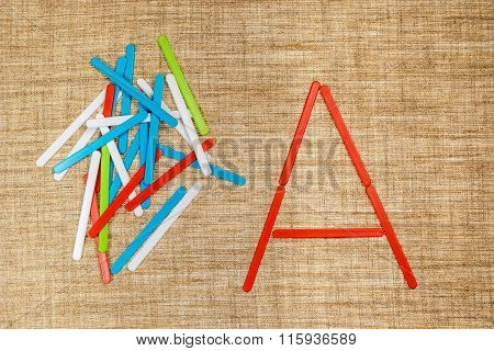 Letters A from children sticks