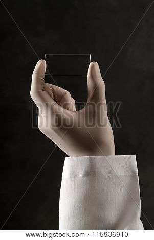 hand using surgical glove in black background