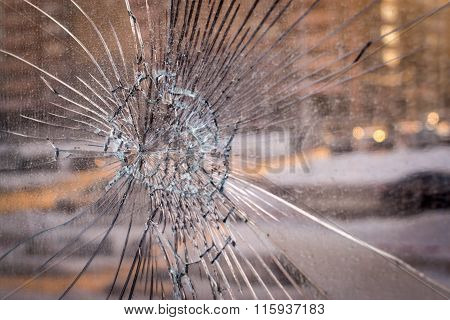 Cracked Broken Glass With City Background