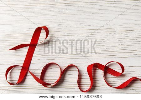 Love Ribbon Word Twisted on White Wood. Valentines Day