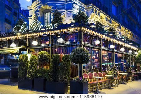 The Famous Restaurant Le Dome In Evening, Paris, France.