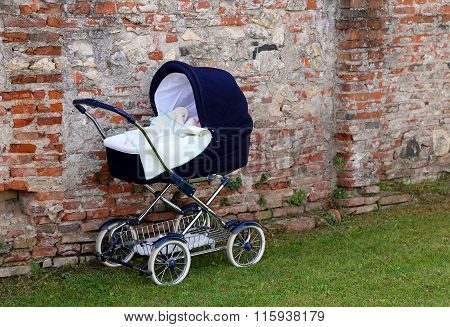 Pram For Newborn Babies On The Garden And The Wall