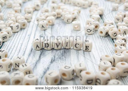 Advice word written on wood block. Wooden ABC