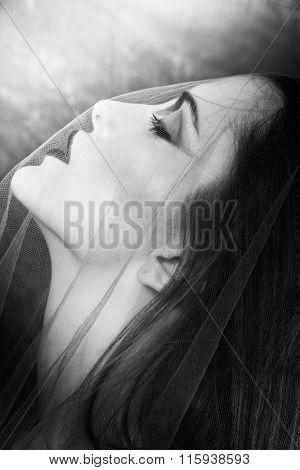 woman under veil portrait black and white closeup