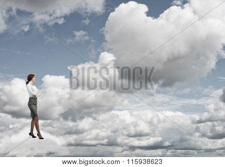 Businesswoman on white cloud