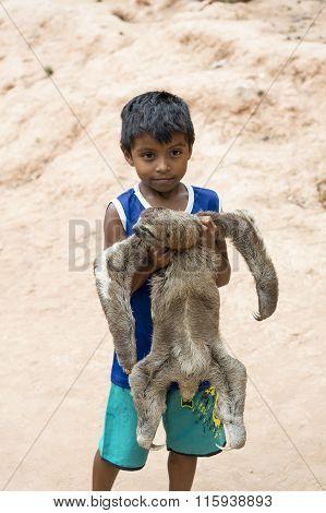 Boy Holding Sloth