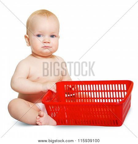 the baby is six months old with a red basket in hands isolated on white