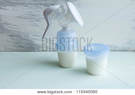 Baby  Manual Breast Pump Ccessories On Table On Grey Background