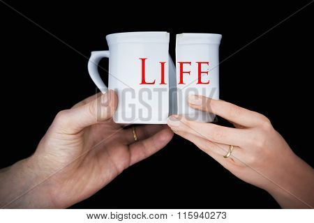 Married Couple With Golder Rings Holding A Broken Mug Entitled Life