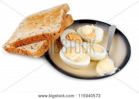 eggs and bread on plate isolated