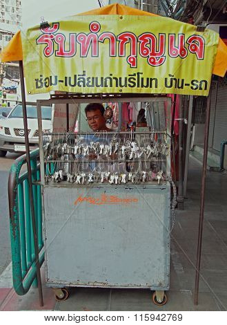 man is selling keys outdoor in Bangkok, Thailand