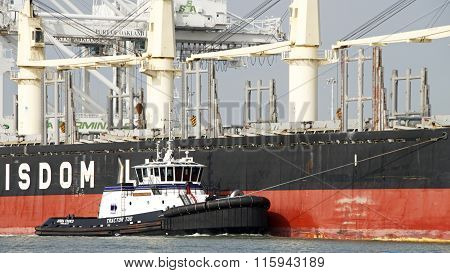 Tugboat Ahbra Franco Off The Starboard Bow Of Bulk Carrier Bunun Ace, Assisting The Vessel To Maneuv