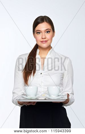 Young woman brings coffee