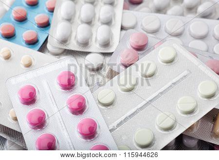 Pile Of Pills In Blister Packs Background