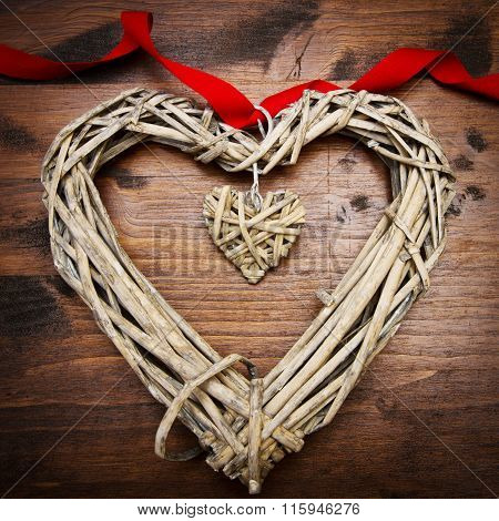 Valentines Day Wood Heart And Ribbon Over Wooden