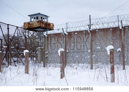 Old Soviet Union prison wall and a guard tower in Estonia.
