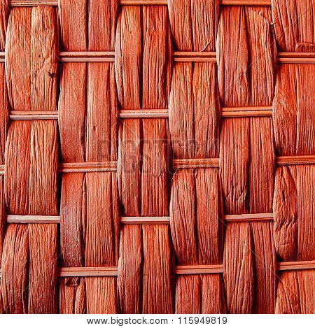 Imaginative Orange Woven Reed / Wood Abstract Background Texture.