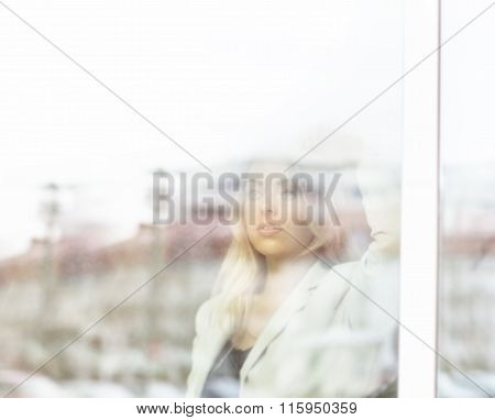 Young Beautiful Successful Business Woman Standing Near The Window Of The Office.