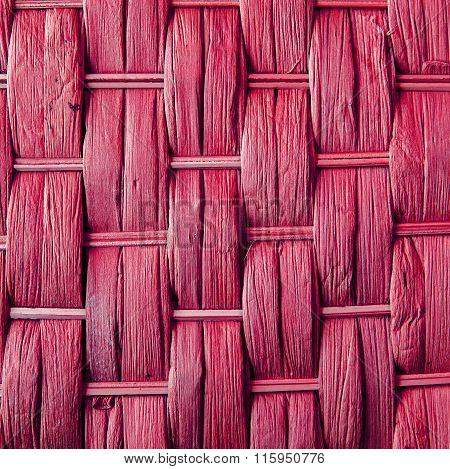 Imaginative Pink Woven Reed / Wood Abstract Background Texture.