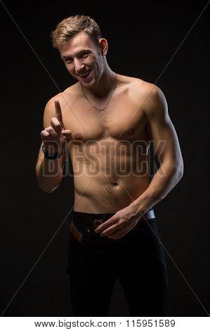 Guy in a black studio