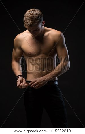 Guy in a black studio