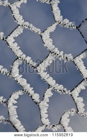 Nature Abstract: Wire Fencing Frost Covered And Freezing In Winter
