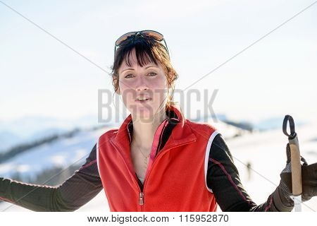 Young Happy Woman With Ski Poles At Winter Skiing