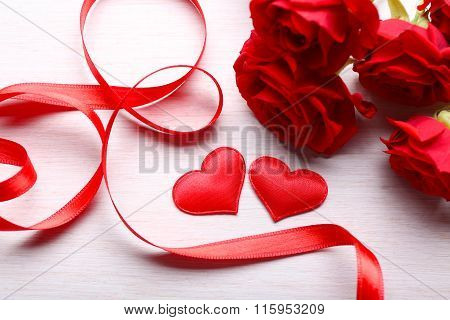 Two Hearts, Ribbon And Roses On Table
