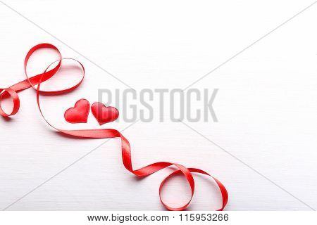 Red Hearts And Ribbon On Light Wooden Background
