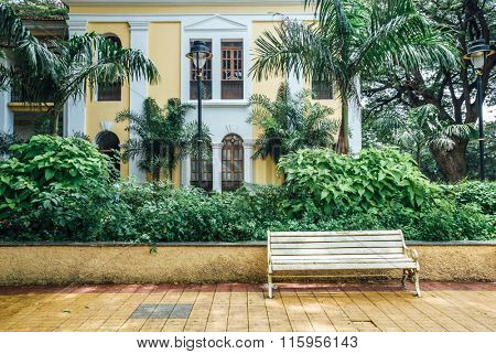 A bench on the backdrop of an old Portuguese style building in Goa, india.